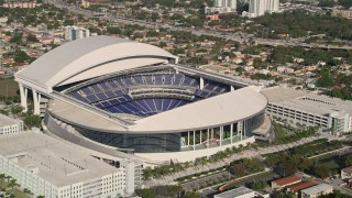 AX0024_029E - 5K stock footage aerial video of flying by Marlins Park Stadium, Miami, Florida