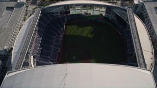 AX0024_034E - 5K stock footage aerial video of approaching Marlins Park, tilt to bird's eye of stadium in Miami, Florida