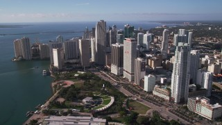 AX0024_040 - 5K stock footage aerial video of flying over Bayfront Park beside skyscrapers, Downtown Miami, Florida