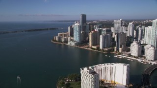 AX0024_044 - 5K stock footage aerial video fly over Mandarin Oriental on Brickell Key toward skyscrapers in Downtown Miami, Florida