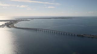 AX0024_047 - 5K stock footage aerial video of flying by the Rickenbacker Causeway on Biscayne Bay, Florida
