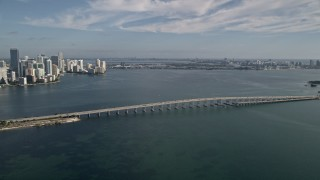 AX0024_050 - 5K stock footage aerial video reverse view of Rickenbacker Causeway and reveal Downtown Miami, Florida