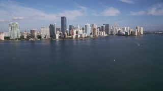 AX0024_052 - 5K stock footage aerial video tilt from Biscayne Bay to reveal Rickenbacker Causeway, Downtown Miami, Florida