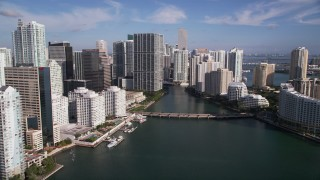 AX0024_055 - 5K stock footage aerial video of approaching Brickell Key Drive bridge, Downtown Miami, Florida