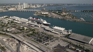 AX0024_063 - 5K stock footage aerial video approach and flyby Disney cruise ship docked at Port of Miami, Miami, Florida