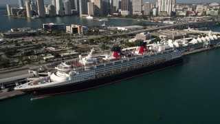 AX0024_064 - 5K stock footage aerial video of orbiting Disney Cruise Ship docked at Port of Miami, Miami, Florida