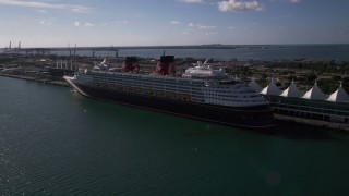 AX0024_066 - 5K stock footage aerial video of approaching and flying by Disney Cruise Ship at Port of Miami, Miami, Florida