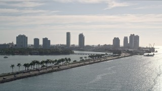 AX0024_068 - 5K stock footage aerial video of tracking traffic on MacArthur Causeway, reveal South Beach, Miami Beach, Florida