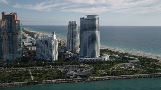 AX0024_075 - 5K stock footage aerial video of flying by Portofino Tower and skyscrapers, South Beach, Miami Beach, Florida
