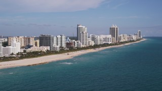 AX0024_082 - 5K stock footage aerial video of flying by hotels along the shore, Miami Beach, Florida