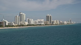 AX0024_082E - 5K stock footage aerial video of flying by hotels along the shore, Miami Beach, Florida