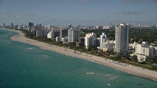 AX0024_089 - 5K stock footage aerial video of flying by hotels, apartment buildings, beach, Miami Beach, Florida