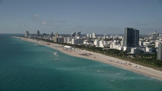 AX0024_092 - 5K stock footage aerial video of flying by hotels by the beach, South Beach, Miami Beach, Florida