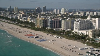 AX0024_093 - 5K stock footage aerial video of flying along the shore of South Beach and passing hotels, Miami Beach, Florida