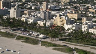 AX0024_094 - 5K stock footage aerial video of flying by maintenance base camp, South Beach, Miami Beach, Florida