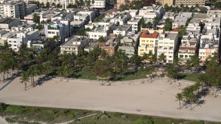 AX0024_095 - 5K stock footage aerial video of flying by palm trees at Lummus Park, South Beach, Miami Beach, Florida