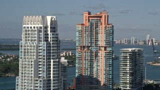 AX0024_097 - 5K stock footage aerial video of flying by Portofino Tower and skyscrapers, South Beach, Miami Beach, Florida