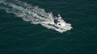 AX0024_105 - 5K stock footage aerial video of orbiting a fishing boat, Atlantic Ocean, Miami, Florida