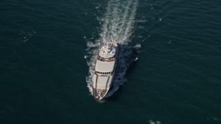 AX0024_107E - 5K stock footage aerial video of tracking a yacht, Atlantic Ocean, Miami, Florida