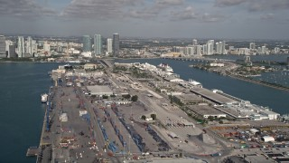 AX0024_117 - 5K stock footage aerial video of flying by Port of Miami and a Disney cruise ship, Miami, Florida