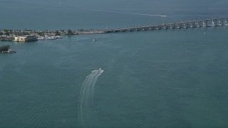 AX0024_118 - 5K stock footage aerial video of approaching speedboat in Biscayne Bay, Miami, Florida