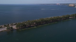 AX0024_120 - 5K stock footage aerial video of light traffic crossing the Rickenbacker Causeway, Miami, Florida