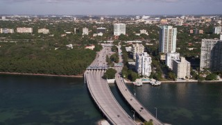 AX0024_121 - 5K stock footage aerial video of the Rickenbacker Causeway becoming State Route 913, Miami, Florida