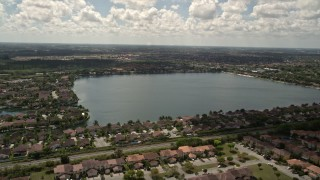 AX0025_001 - 5K aerial stock footage video of flying over homes in Three Lakes, Miami, Florida
