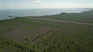 AX0025_011 - 5K stock footage aerial video of flying over Mangrove Preserve, revealing canal and coastline, Homestead, Florida