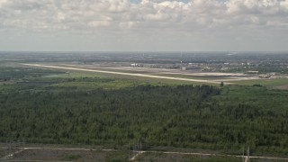 AX0025_014 - 5K stock footage aerial video of flying by Homestead Base, Homestead, Florida