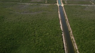 AX0025_016 - 5K stock footage aerial video flyby canal, reveal length of canal and Mangrove Preserve, Homestead, Florida