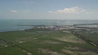 AX0025_020 - 5K stock footage aerial video of flying by power lines, revealing Turkey Point Power Plant, Homestead, Florida