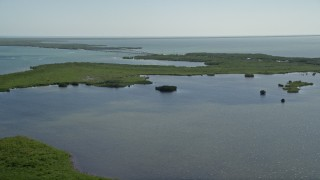 AX0025_032 - 5K stock footage aerial video of flying over a lagoon with Card Sound Bridge in the distance, Homestead, Florida