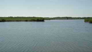AX0025_038 - 5K stock footage aerial video of flying low over coastal mangroves, Model Lands Basin, Homestead, Florida