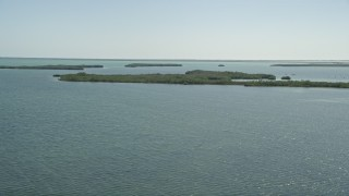 AX0025_043 - 5K stock footage aerial video of flying by coastal mangroves, Model Lands Basin, Homestead, Florida