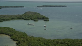 AX0025_044 - 5K stock footage aerial video of flying by lagoon, fishing and sail boats, Model Lands Basin, Homestead, Florida