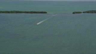 AX0025_045 - 5K stock footage aerial video of flying by a speedboat on Manatee Bay, Boynton Beach, Florida