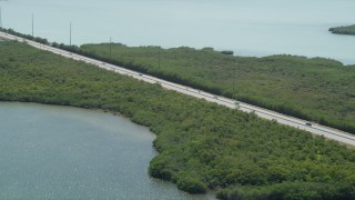 AX0025_046 - 5K stock footage aerial video of tracking light traffic on Overseas Highway, Key Largo, Florida