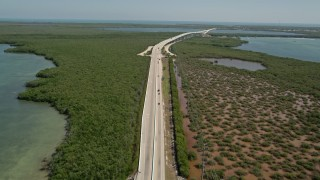 AX0025_051 - 5K stock footage aerial video follow traffic on Overseas Highway, Key Largo, Florida
