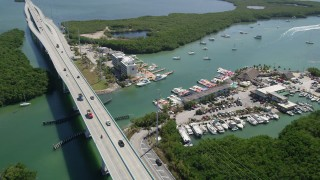 AX0025_053 - 5K stock footage aerial video of Anchorage Resort and Yacht Club, and Gilbert's Resort, Key Largo, Florida