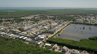 AX0025_056 - 5K stock footage aerial video of flying by waterfront homes on canals, Key Largo, Florida