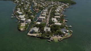 AX0025_058 - 5K stock footage aerial video of approaching homes on shore of Sexton Cove, Key Largo, Florida