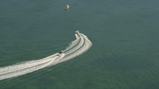 AX0025_060 - 5K stock footage aerial video of fishing boats on Blackwater Sound, Key Largo, Florida