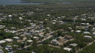 AX0025_062 - 5K stock footage aerial video of flying by homes on canals, Key Largo, Florida