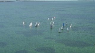 AX0025_067 - 5K stock footage aerial video of flying by sailboats on Buttonwood Sound, Key Largo, Florida