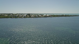 AX0025_070 - 5K stock footage aerial video of flying by homes on Buttonwood Sound, Key Largo, Florida