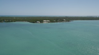 AX0025_084 - 5K stock footage aerial video of approaching a home on the shore, Tavernier, Florida