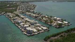 AX0025_086 - 5K aerial stock footage video of flying over homes on the shore, Tavernier, Florida
