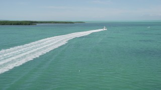 AX0025_096 - 5K stock footage aerial video of tailing a fishing boat sailing near Tavernier, Florida
