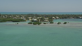 AX0025_099 - 5K stock footage aerial video of approaching homes on the shore, Tavernier, Florida